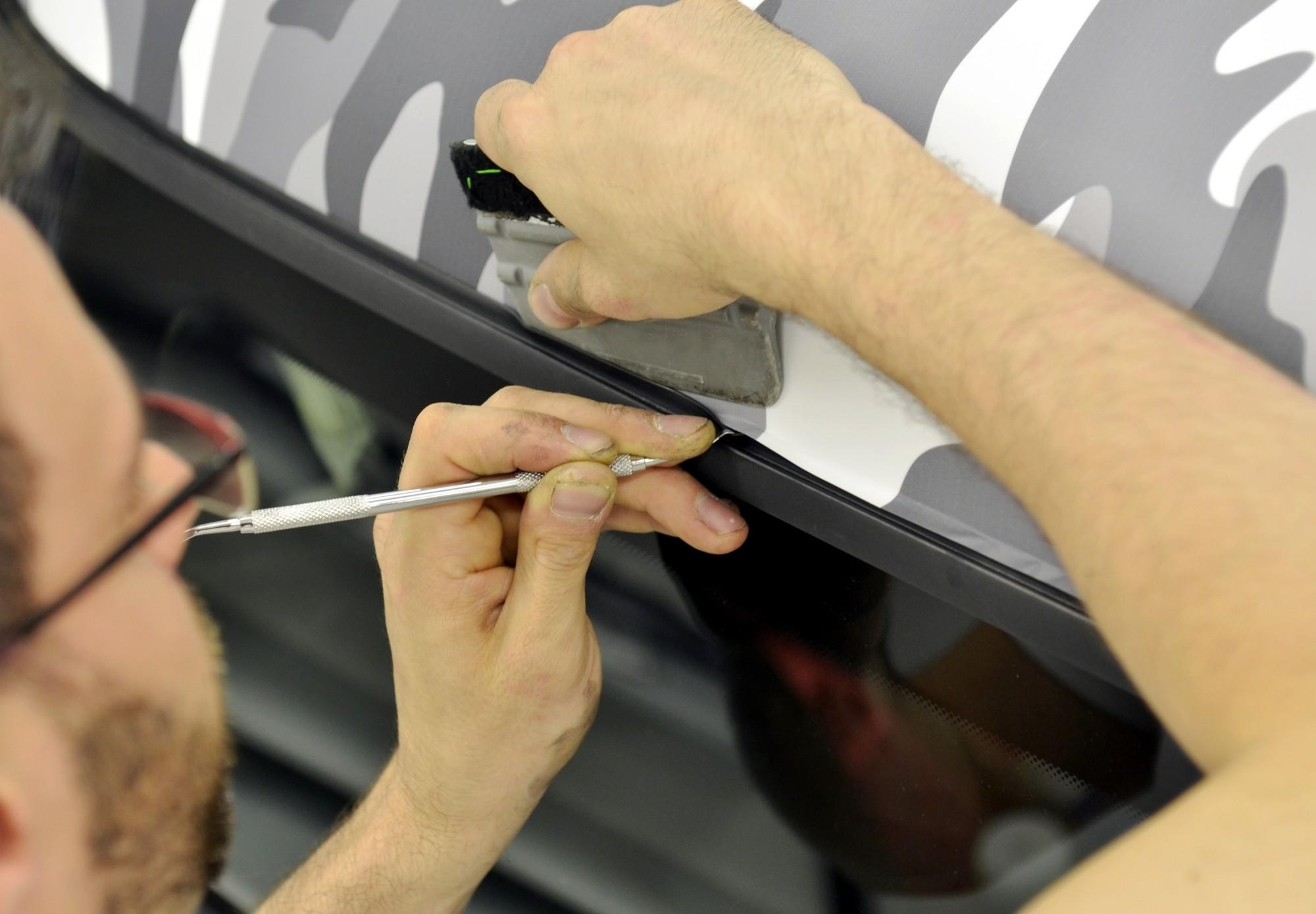 person applying vinyl wrap