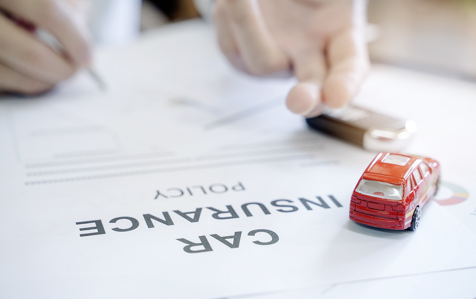 car insurance policy with toy car